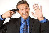 Businessman Holding Gun To His Head While Smiling And Waving