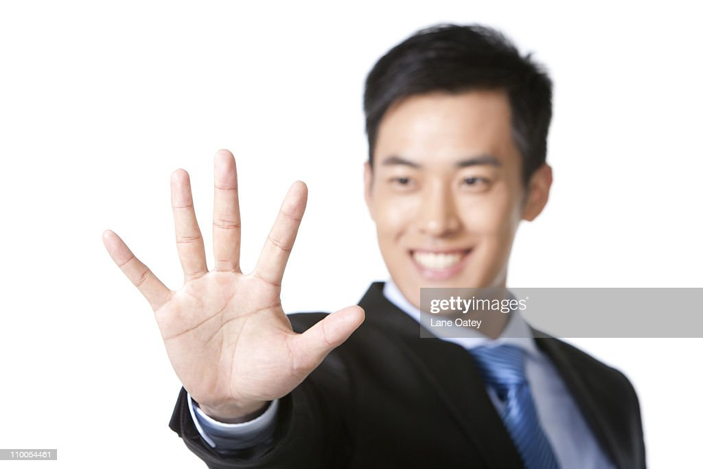Technology Management Image: Businessman Holding Hand Out In Front Stock Photo
