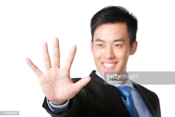 Businessman holding hand out in front
