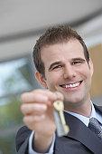 Businessman Holding Key