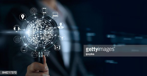 Businessman holding magnifying glass, search payments online shopping and icon customer network connection on screen, m-banking and omni channel : Foto stock