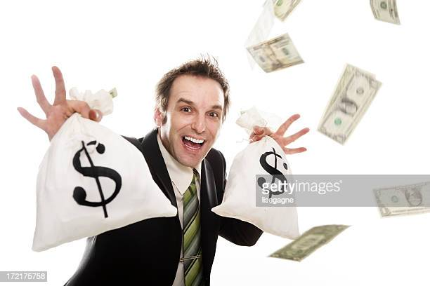 Businessman holding money bags