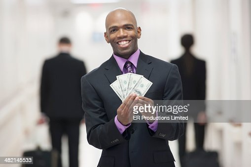Businessman Holding Money In Office Stock Photo | Getty Images