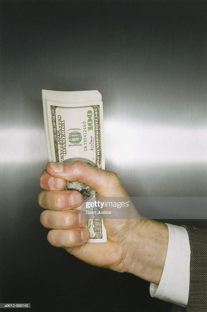 Businessman Holding Money : Stock Photo
