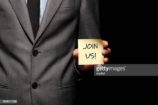 Businessman Holding Notepad-Join Us Concept