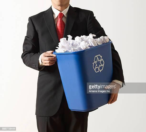 Businessman Holding Recycling Paper Bin