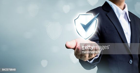 Businessman holding shield protect icon, Concept cyber security safe your data : Stock Photo