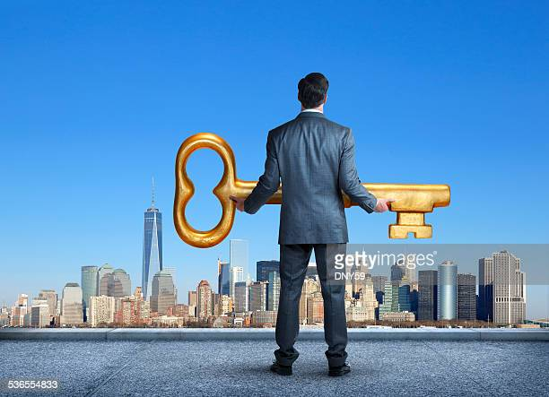 Businessman Holding The Key ToThe City