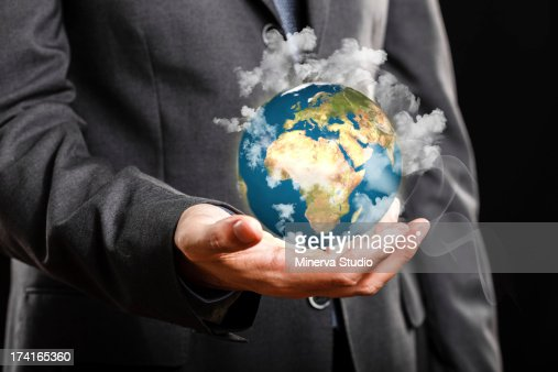 Businessman holding the world in his hand : Stock Photo