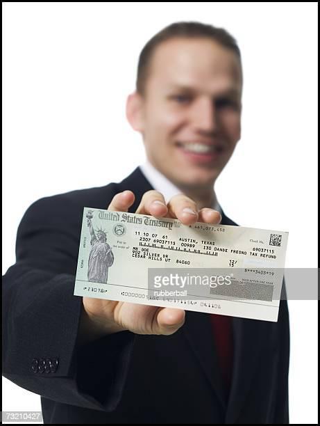 Businessman holding US Treasury check