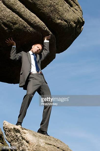 Businessman Holds Up Huge Boulder in the Sky