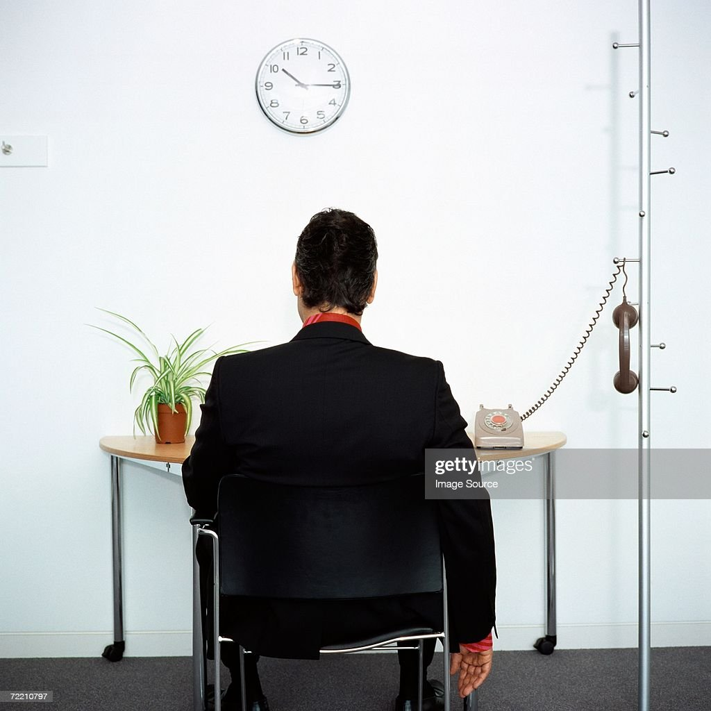 Businessman ignoring telephone : Stock Photo