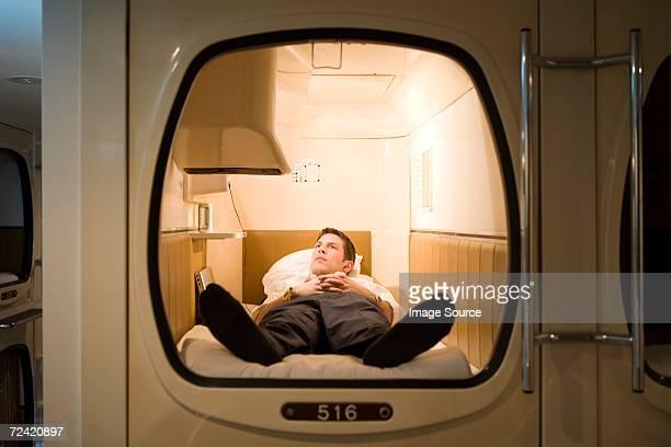 Businessman in a capsule hotel