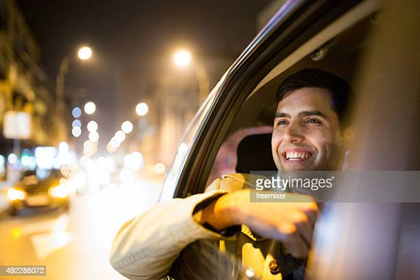 Businessman in a car at night