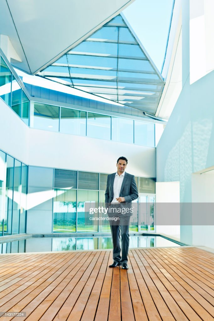 Businessman in a contemporary design building : Stock Photo