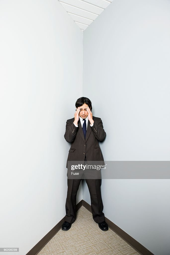 Businessman in a corner : Stock Photo