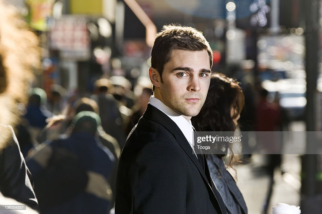 Businessman in a crowd : Stock Photo