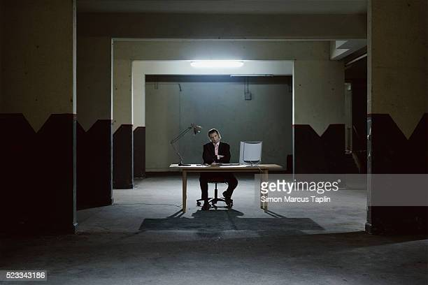 Businessman in a Dark Room