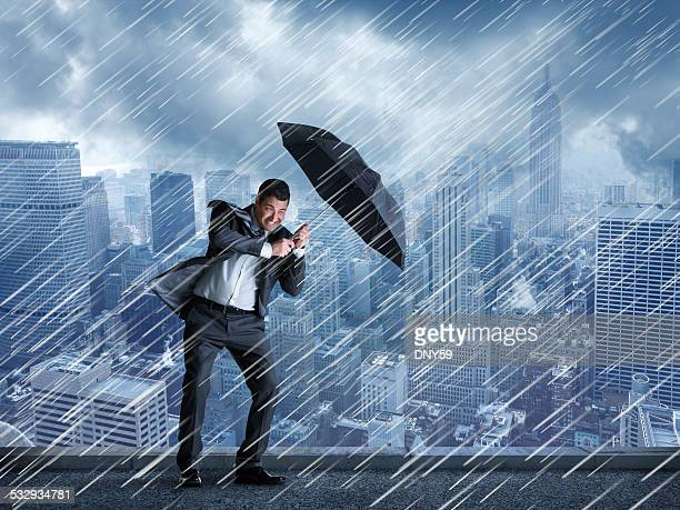 Businessman In A Rainstorm