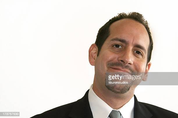 Businessman in a suit looking at camera