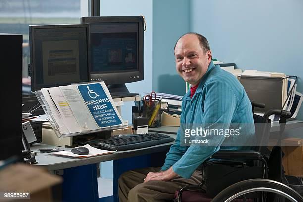 Businessman in a wheelchair in an office