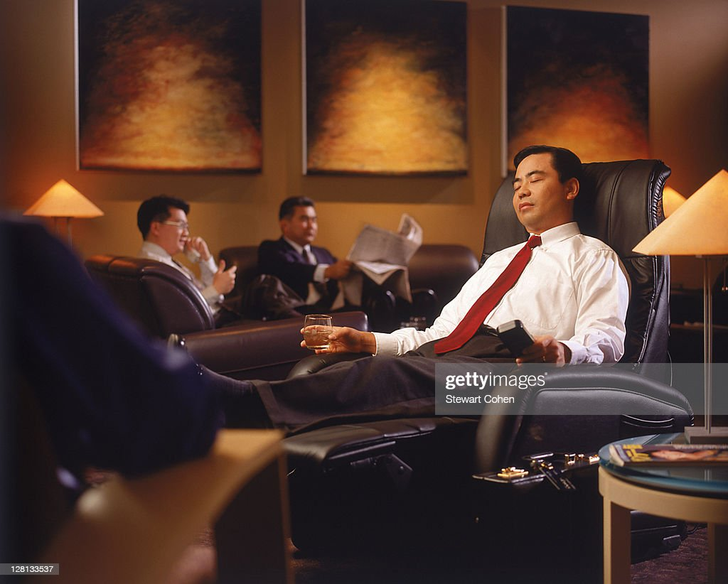 Businessman in airport lounge : Stock Photo