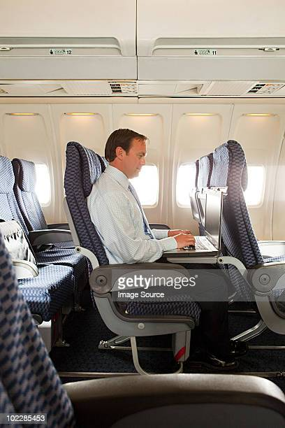Businessman in an airplane