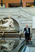 Businessman in Atrium of Montreal's World Trade Center