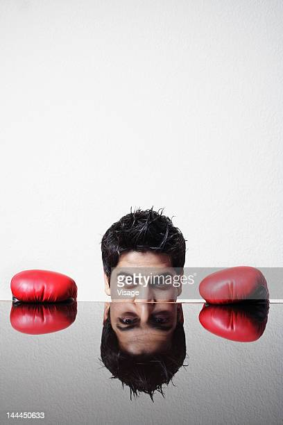 A businessman in boxing gloves