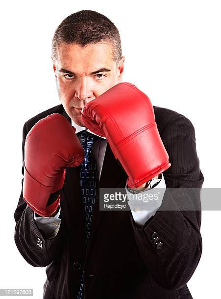 Businessman in boxing gloves ready to attack or defend