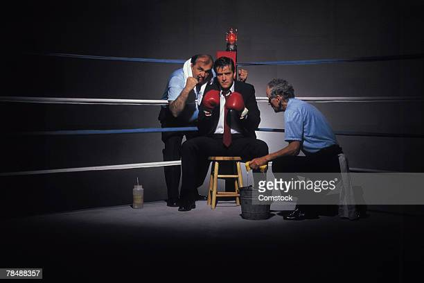 Businessman in boxing ring corner