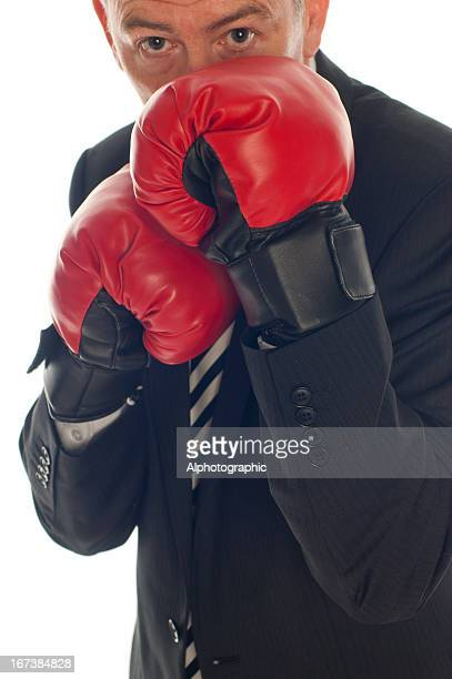 Businessman in boxing stance