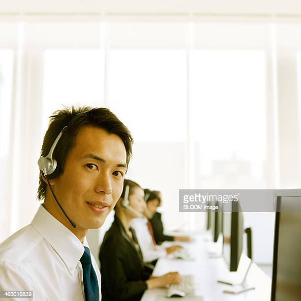Businessman In Call Centre