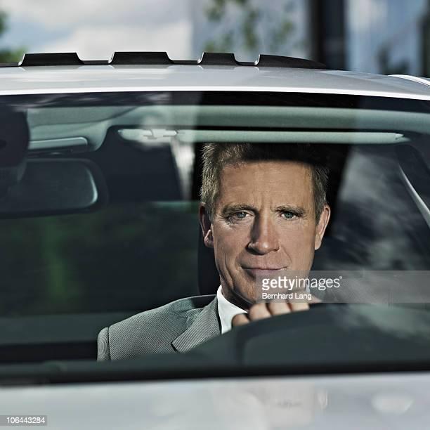 Businessman in car, close up