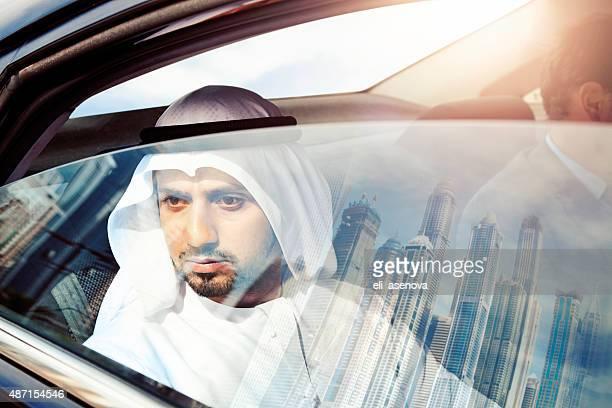 Businessman in car in Dubai.