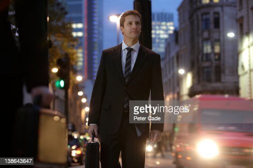 businessman in city at night : Stock Photo