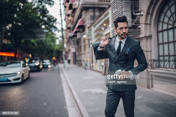 Businessman in city with coffee
