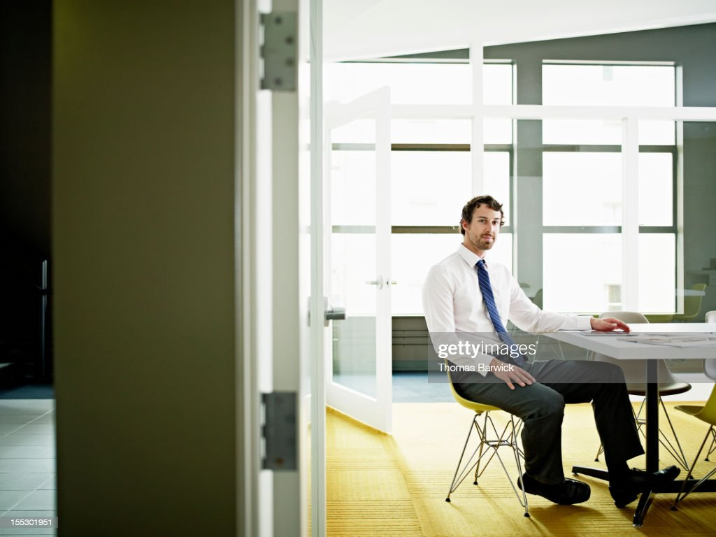 Businessman in conference room with digital tablet : Stock Photo