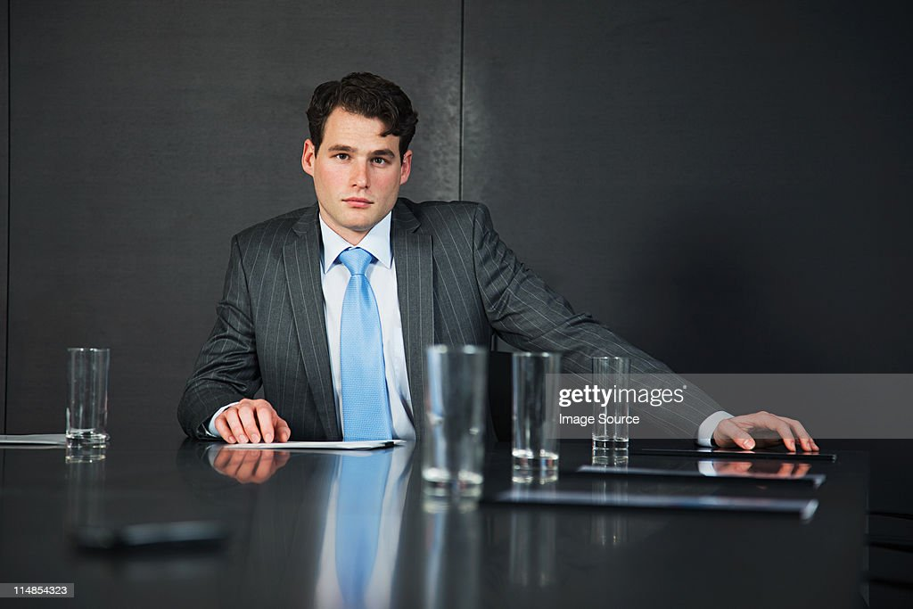 Businessman in conference room with documents : Stock Photo