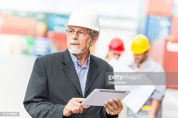 Businessman in Container Warehouse