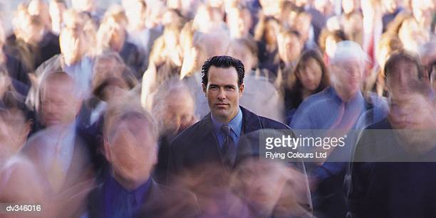 Businessman in crowd of pedestrians