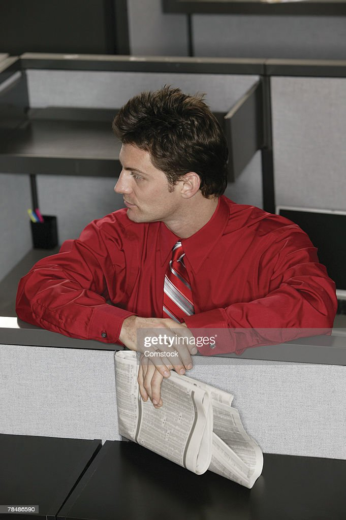 Businessman in cubicle : Stock Photo
