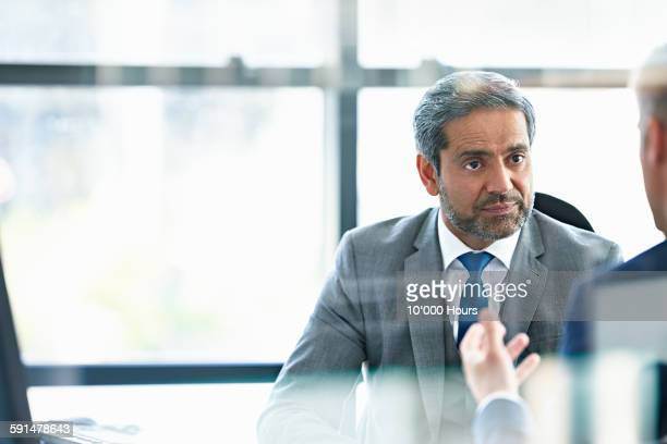 Businessman in discussion with client