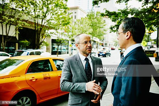 Businessman in discussion with colleague