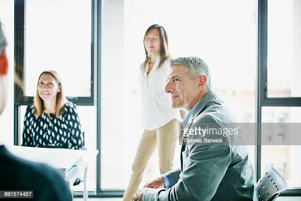 Businessman in discussion with coworkers