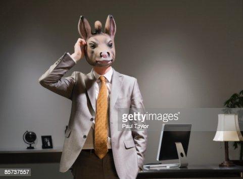 Businessman in donkey mask