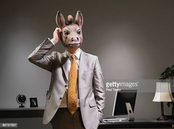 Businessman in donkey mask