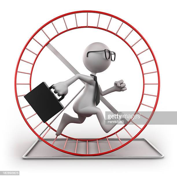 Businessman in exercise wheel, isolated with clipping path