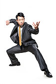 Businessman in fighting stance