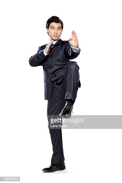 Businessman in fighting stance with hands up